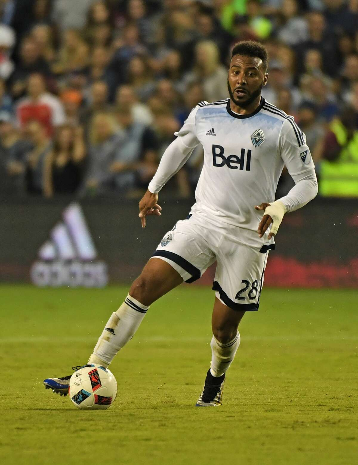 KANSAS CITY, KS - AUGUST 20: Forward Giles Barnes #28 of the Vancouver Whitecaps FC dribbles the ball up the field against Sporting Kansas City during the first half on August 20, 2016 at Children's Mercy Park in Kansas City, Kansas. (Photo by Peter G. Aiken/Getty Images)