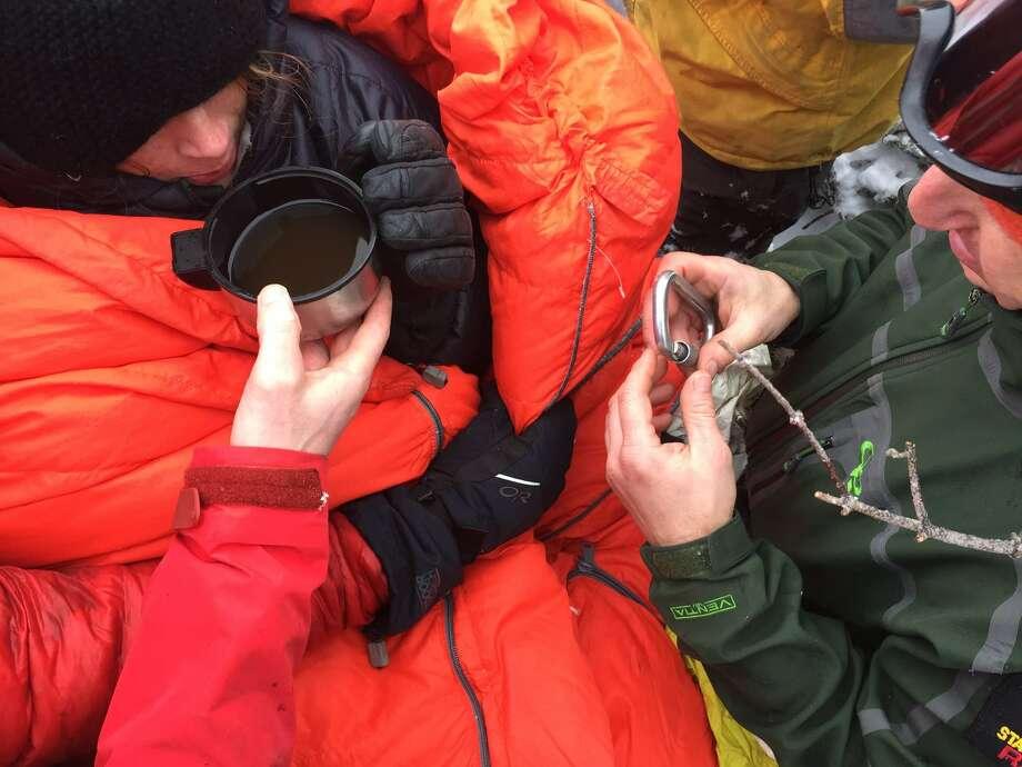 Lost hiker Maddie Popolizio drinks warm liquid after being found by rescue crews Dec. 13, 2016 on the Alonquin Peak. (New York State Department of Environmental Conservation) ORG XMIT: wXq0f2lCEog2LK96usx3