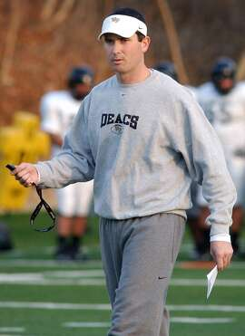 In this Dec. 9, 2006 file photo Tommy Elrod walks on the field while he was serving as assistant coach at Wake Forest University. Elrod, who has served as a radio announcer for the Deacons football games since 2014, has been identified by Wake Forest as the source of leaked game plans found at the University of Louisville. (Kelly Bennett/Winston-Salem Journal via AP)