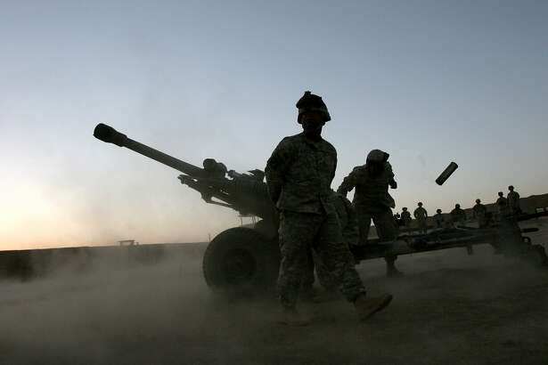 A U.S. soldier throws an artillery shell after firing a 105-mm howitzer at a new U.S. military base outside the village of Musa Qala, Helmand Province, south Afghanistan, Thursday, June 15, 2006. More U.S. soldiers are moving into the region in support of military operation Mountain Thrust, in southern Afghanistan.  (AP Photo/Rodrigo Abd)
