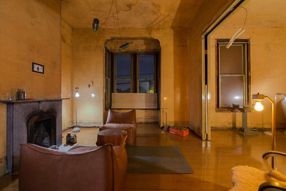 Double parlor of the David Ireland House at night. Photo: Takashi Fukuda, Courtesy 500 Capp St. Foundation