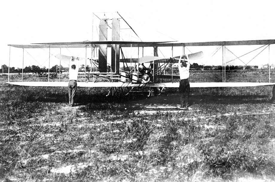 Wilbur Wright and Orville Wright with the Famous Kitty Hawk, Wright Brothers' airplane, in 1903. The plane made a one-minute flight underits own power and carrying a man. The Wright Brothers are shown starting their primitive motors. Photo: New York Daily News Archive/NY Daily News Via Getty Images