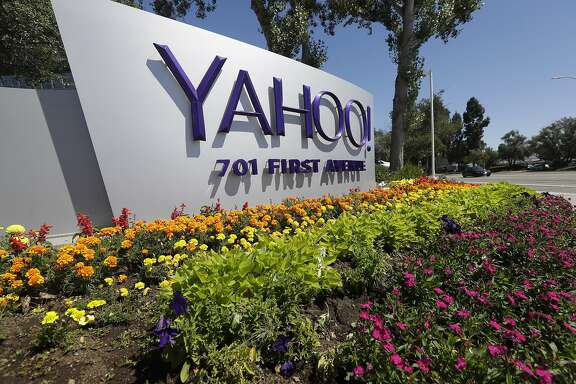 FILE - This Tuesday, July 19, 2016 photo shows a Yahoo sign at the company's headquarters in Sunnyvale, Calif. On Wednesday, Dec. 14, 2016, Yahoo said it believes hackers stole data from more than one billion user accounts in August 2013. (AP Photo/Marcio Jose Sanchez)