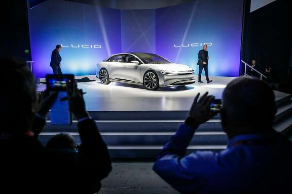 CTO Peter Rawlinson (left) and vice president of design, Derek Jenkins (right) unveil the new Lucid luxury electric car , in Fremont, Calif., on Wednesday, Dec. 14, 2016.