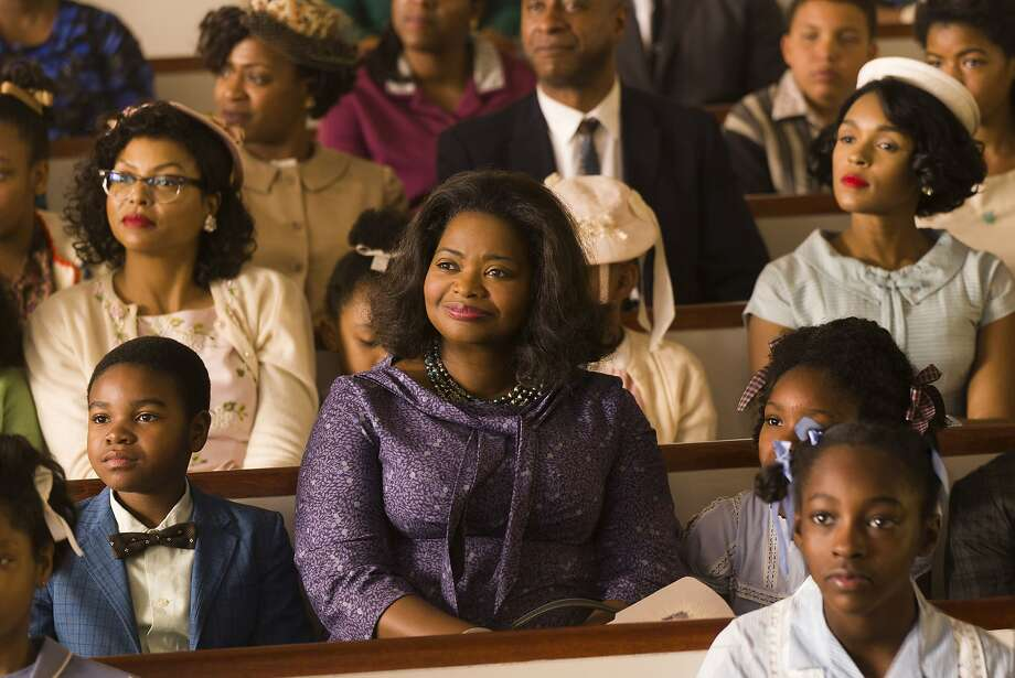 "Taraji P. Henson (background left), Octavia Spencer (center) and Janelle Monáe (background right) in ""Hidden Figures."" Photo: Hopper Stone, Associated Press"
