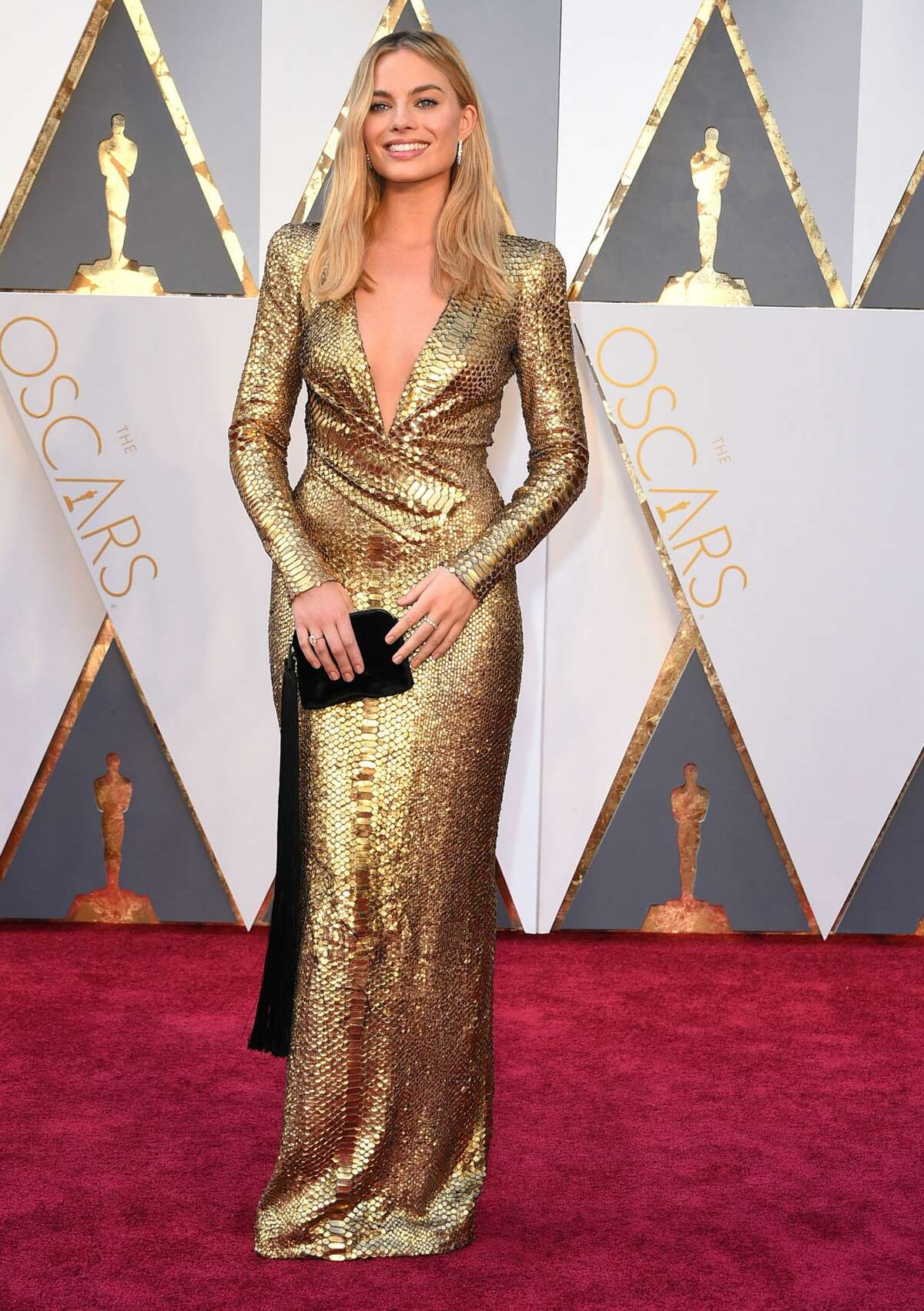 Best: Margot Robbie is a shimmering dream. Her gown looks like liquid gold poured on her. Event: 88th Annual Academy Awards