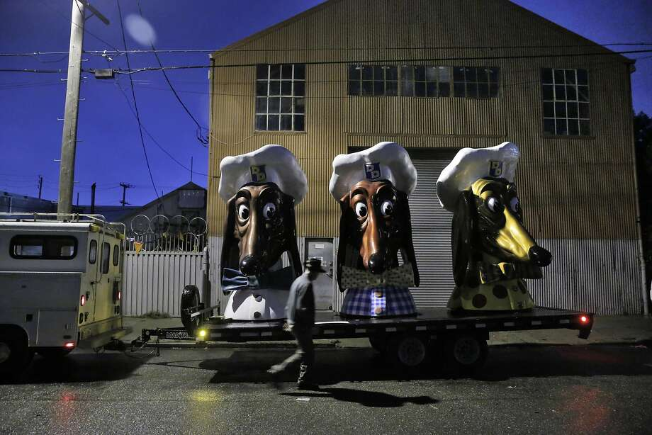 Artist John Law has placed his three restored Doggie Diner Dog Heads outside the Cycleside Swearhouse where he and other resident artist are protesting potentially losing their home in San Francisco, Calif., on Wednesday, December 14, 2016. The Cyclecide Swearhouse has been a hub for what's left of San Francisco's underground arts and maker scenes. After a dispute with their landlord, the artists, most of whom used it just as a workspace and event venue, reached a settlement extending their lease through May. But on the Monday after the Ghost Ship fire, inspectors showed up, and now it appears their landlord is using the tragedy as an excuse to push them out immediately. Photo: Carlos Avila Gonzalez, The Chronicle