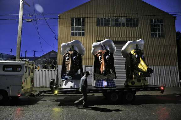 Artist John Law has placed his three restored Doggie Diner Dog Heads outside the Cycleside Swearhouse where he and other resident artist are protesting potentially losing their home in San Francisco, Calif., on Wednesday, December 14, 2016. The Cyclecide Swearhouse has been a hub for what's left of San Francisco's underground arts and maker scenes. After a dispute with their landlord, the artists, most of whom used it just as a workspace and event venue, reached a settlement extending their lease through May. But on the Monday after the Ghost Ship fire, inspectors showed up, and now it appears their landlord is using the tragedy as an excuse to push them out immediately.