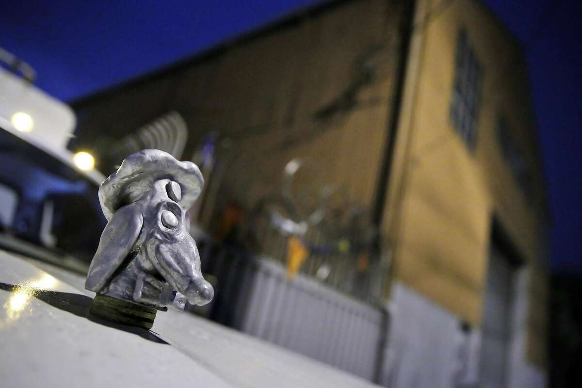 The hood ornament on the truck artist John Law used to place his three restored Doggie Diner Dog Heads outside the Cycleside Swearhouse where he and other resident artist are protesting potentially losing their home in San Francisco, Calif., on Wednesday, December 14, 2016. The Cyclecide Swearhouse has been a hub for what's left of San Francisco's underground arts and maker scenes. After a dispute with their landlord, the artists, most of whom used it just as a workspace and event venue, reached a settlement extending their lease through May. But on the Monday after the Ghost Ship fire, inspectors showed up, and now it appears their landlord is using the tragedy as an excuse to push them out immediately.