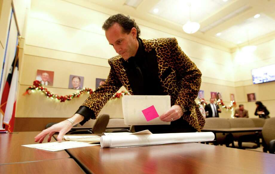 Jimmy Cusani, with Richland Hills-based Your Chamber Connection, sorts through chamber member certificates during the Conroe/Lake Conroe Area Chamber of Commerce's annual membership drive at the chamber's building Dec. 8 in Conroe. Photo: Jason Fochtman, Staff Photographer / Houston Chronicle