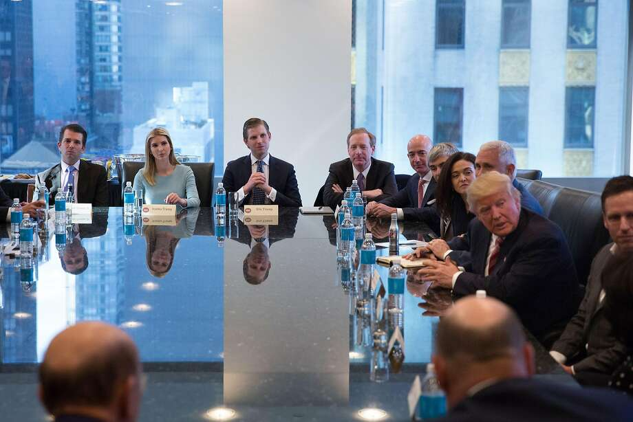 President-elect Donald Trump, along with his children, Ivanka Trump, Eric Trump and Donald Trump, Jr. meet with leaders from around the tech sector, at Trump Tower in Manhattan, Dec. 14, 2016. Among those seated at the end of the table are Trump's adult children, from left: Donald Jr., Ivanka and Eric Trump. (Kevin Hagen/The New York Times) Photo: KEVIN HAGEN, NYT