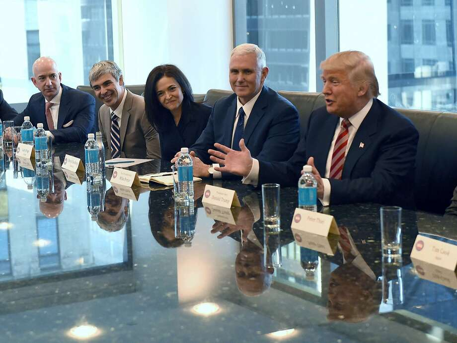 (L-R) Amazon's chief Jeff Bezos, Larry Page of Alphabet, Facebook COO Sheryl Sandberg, Vice President-elect Mike Pence and President-elect  Donald Trump at Trump Tower December 14, 2016. Trump is meeting with top tech executives -- including several of his sharpest critics -- to mend fences after a divisive election in which the majority of Silicon Valley backed Hillary Clinton. / AFP PHOTO / TIMOTHY A. CLARYTIMOTHY A. CLARY/AFP/Getty Images Photo: TIMOTHY A. CLARY, AFP/Getty Images