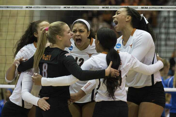 Texas volleyball players celebrate a point during their 2016 NCAA Tournament match against Creighton at Gregory Gym in Austin.