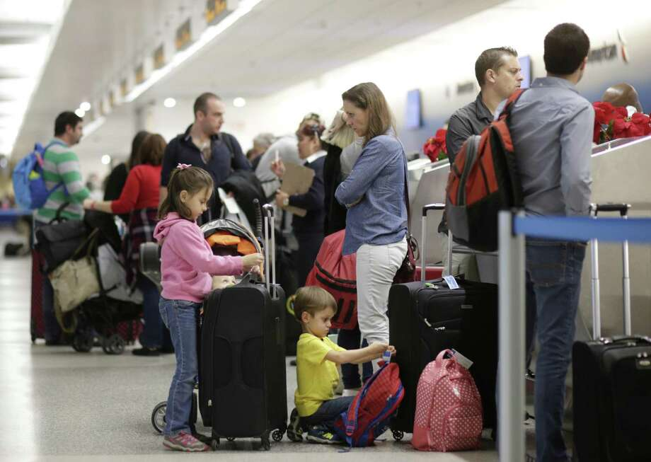 "Travelers wait at the ticket counter at Miami International Airport. Studies indicate that the chances of such customers witnesssing incidents of ""sky rage"" are on the rise. Photo: Lynne Sladky /Associated Press / Copyright 2016 The Associated Press. All rights reserved."