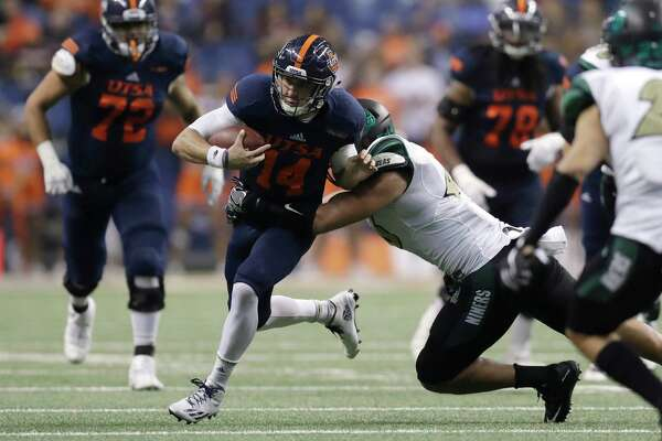 UTSA quarterback Dalton Sturm (14) is hit by Charlotte linebacker Alex Highsmith (46) during the second half of an NCAA college football game, Saturday, Nov. 26, 2016, in San Antonio. (AP Photo/Eric Gay)