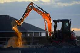 Work continues near the Legacy Addition housing development by Avalon Drive south of Hwy 191 on Nov. 11, 2016.   James Durbin/Reporter-Telegram