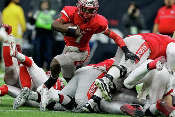 Bremond quarterback Roshauud Paul runs to daylight at NRG Stadium en route to the second of his three consecutive Class 2A state championships.
