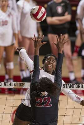 Stanford's Inky Ajanaku spikes the ball during a win over USC on Oct. 28.