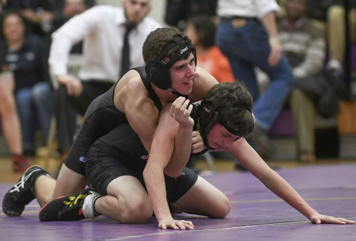 Efthimios Barkas (top) of the Westhill Vikings controls Billy Griffin of the Stamford Black Knights during a match at Westhill High School on December 14, 2016 in Stamford, Connecticut.