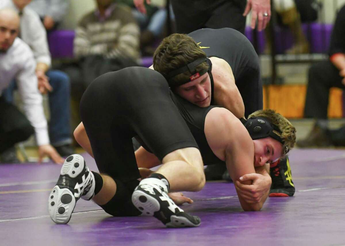 Kyle Alswanger-Busch (top) of the Westhill Vikings controls Cody Tromba of the Stamford Black Knights during a match at Westhill High School on December 14, 2016 in Stamford, Connecticut.