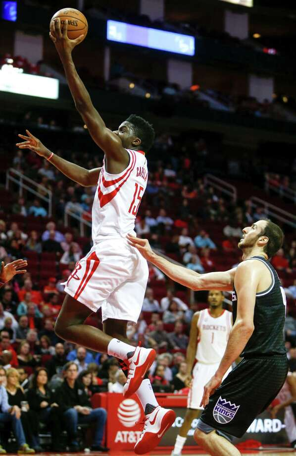 Houston Rockets center Clint Capela (15) drives to the basket past Sacramento Kings center Kosta Koufos (41) during the first quarter of an NBA basketball game at Toyota Center on Wednesday, Dec. 14, 2016, in Houston. Photo: Brett Coomer, Houston Chronicle / © 2016 Houston Chronicle