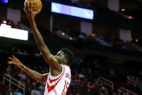 Houston Rockets center Clint Capela (15) drives to the basket past Sacramento Kings center Kosta Koufos (41) during the first quarter of an NBA basketball game at Toyota Center on Wednesday, Dec. 14, 2016, in Houston.