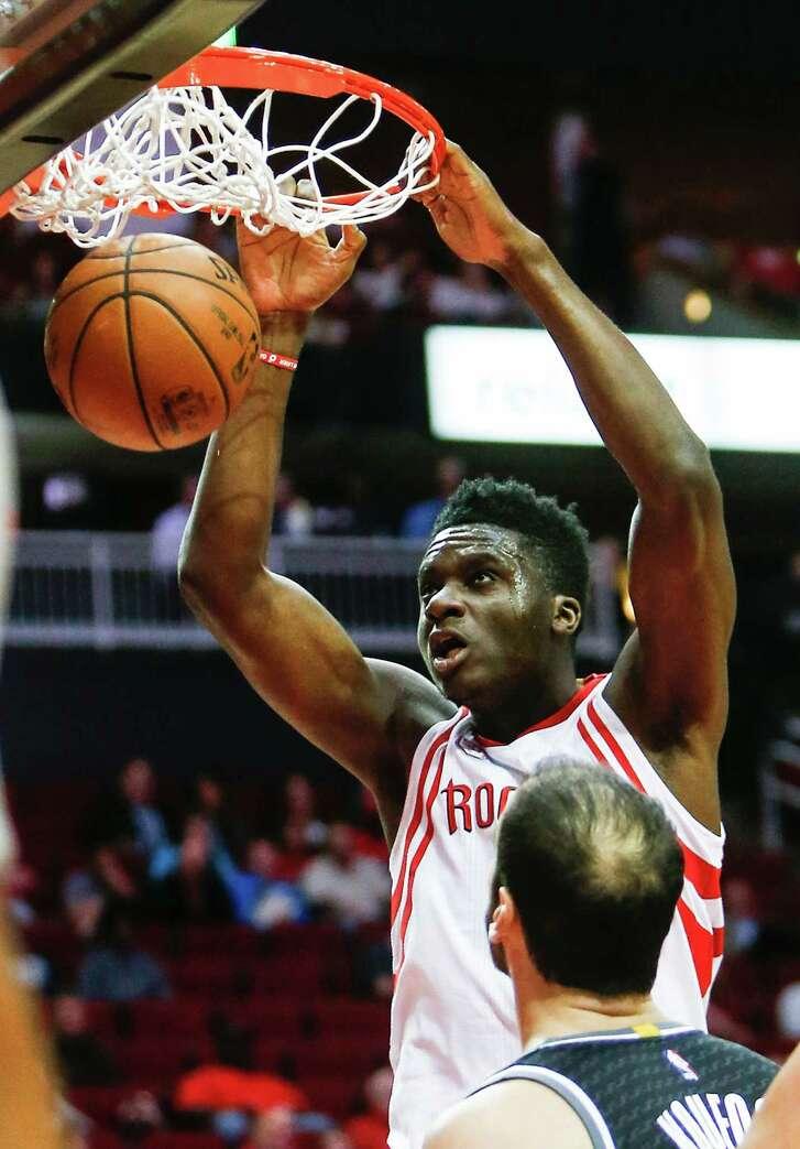 Houston Rockets center Clint Capela (15) dunks over Sacramento Kings center Kosta Koufos (41) during the first quarter of an NBA basketball game at Toyota Center on Wednesday, Dec. 14, 2016, in Houston.
