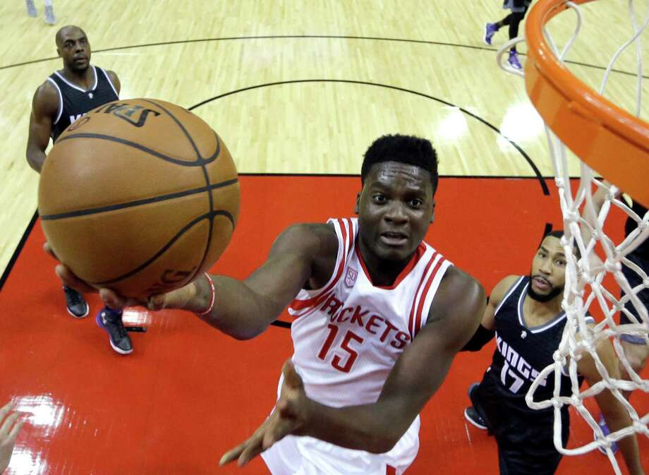 Houston Rockets' Clint Capela (15) shoots as Sacramento Kings' Garrett Temple (17) defends during the first half of an NBA basketball game Wednesday in Houston. Photo: David J. Phillip, Associated Press / Copyright 2016 The Associated Press. All rights reserved.