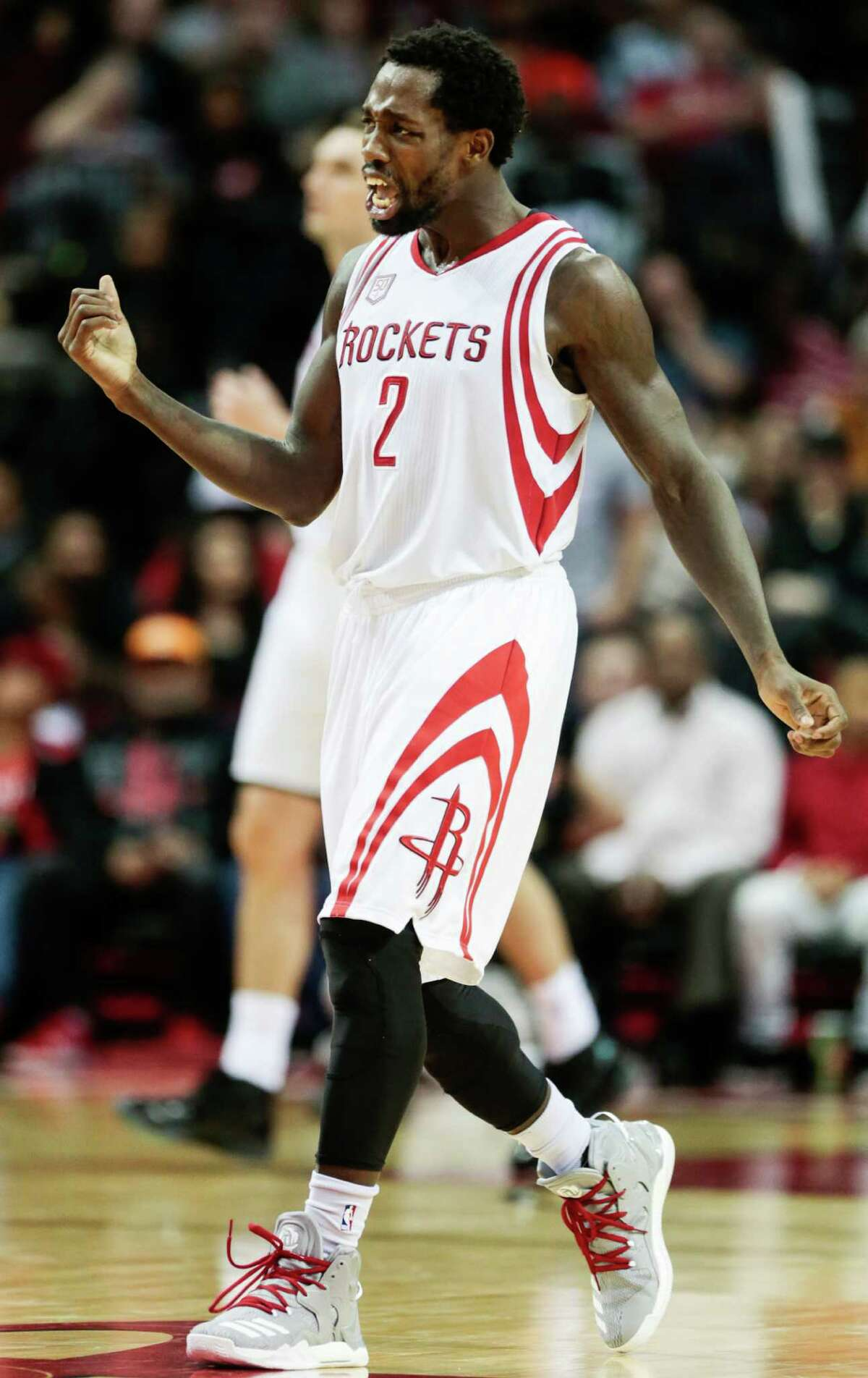 Houston Rockets guard Patrick Beverley (2) reacts after dishing off an assist against the Sacramento Kings during the second half of an NBA basketball game at Toyota Center on Wednesday, Dec. 14, 2016, in Houston.