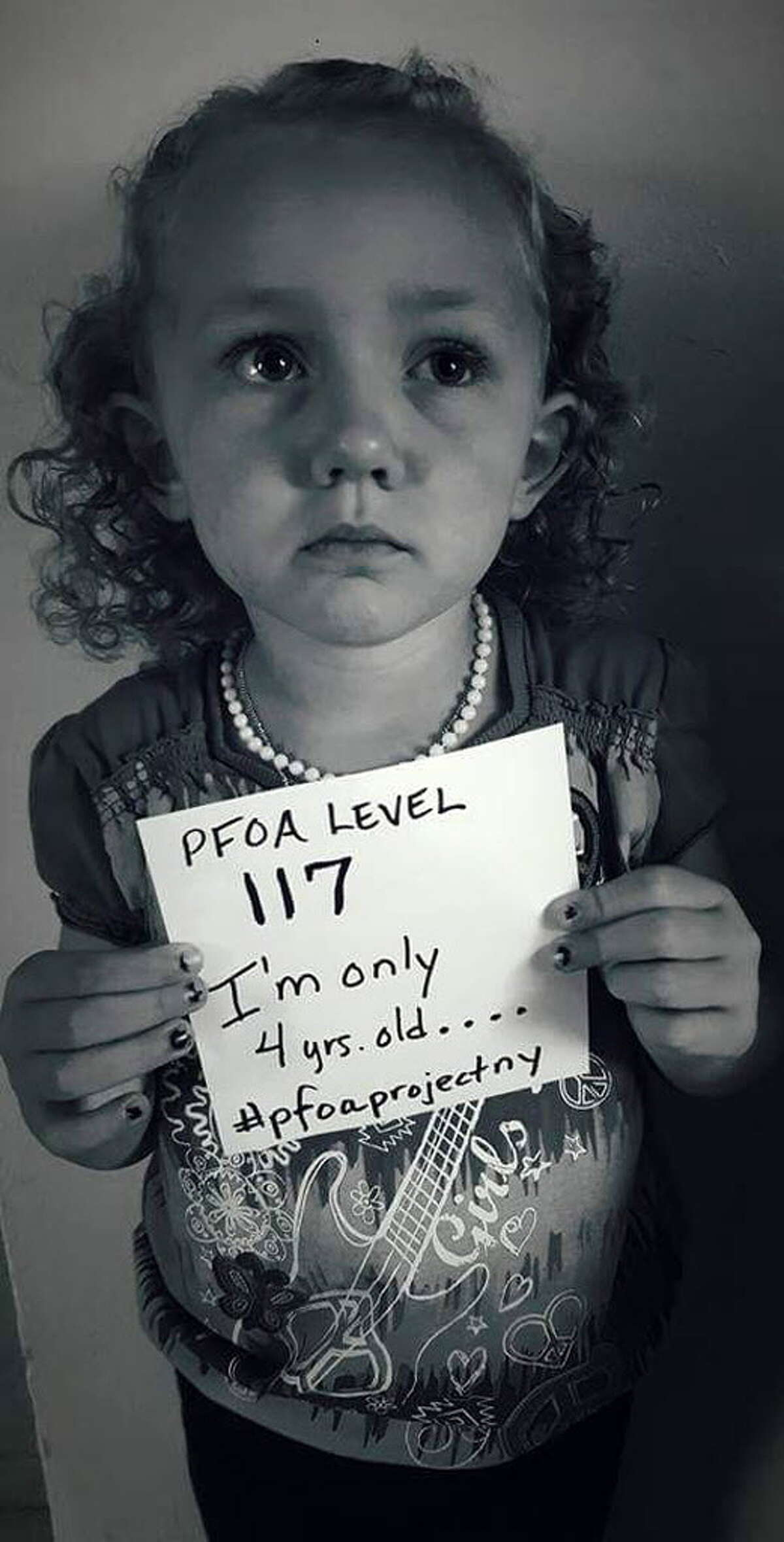 Hoosick Falls resident, Alyssa Aldrich, 4, displays a sign with her body's PFOA level after receiving the results of a recent blood test conducted by the state. The photo was posted on Twitter by parents, Josh and Nikki Aldrich. (Courtesy Josh and Nikki Aldrich)