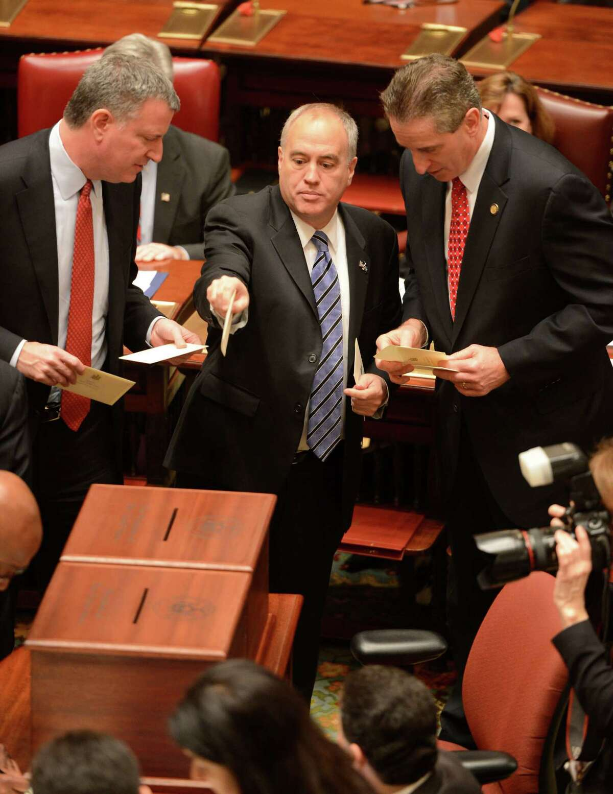 Bill DeBlasio, left Thomas DiNapoli, center and Lt. Governor Bob Duffy, right all members of the New York State Electoral College cast their ballot during the 57th meeting of the electoral college which took place in the Senate Chamber of the State Capitol on Dec 17, 2012, in Albany, N.Y. (Skip Dickstein/Times Union archive)