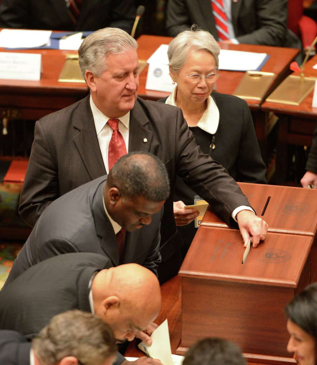 Albany Mayor Jerry Jennings a member of the New York State Electoral College cast his ballot during the 57th meeting of the electoral college which took place in the Senate Chamber of the State Capitol on Dec 17, 2012, in Albany, N.Y. (Skip Dickstein/Times Union archive)