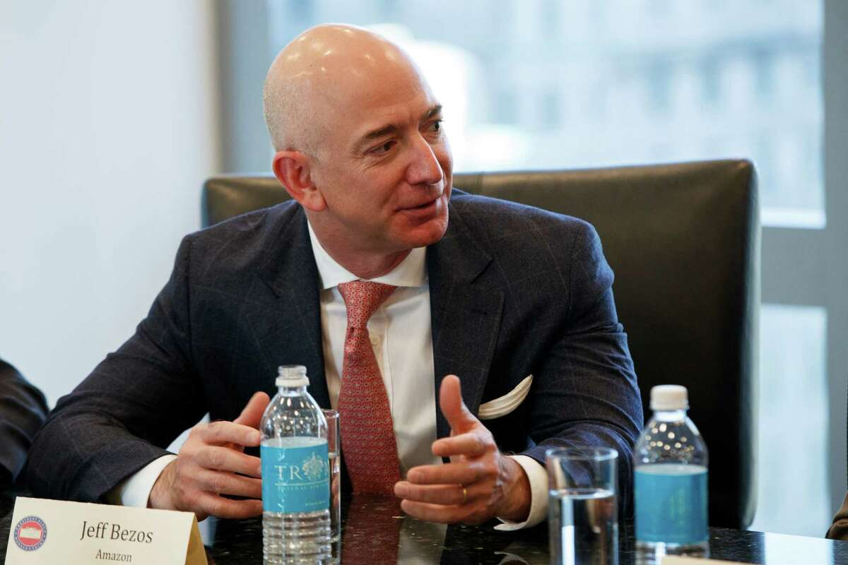 Amazon founder Jeff Bezos speaks during a meeting with President-elect Donald Trump and technology industry leaders at Trump Tower in New York, Wednesday, Dec. 14, 2016. (AP Photo/Evan Vucci) ORG XMIT: NYEV112