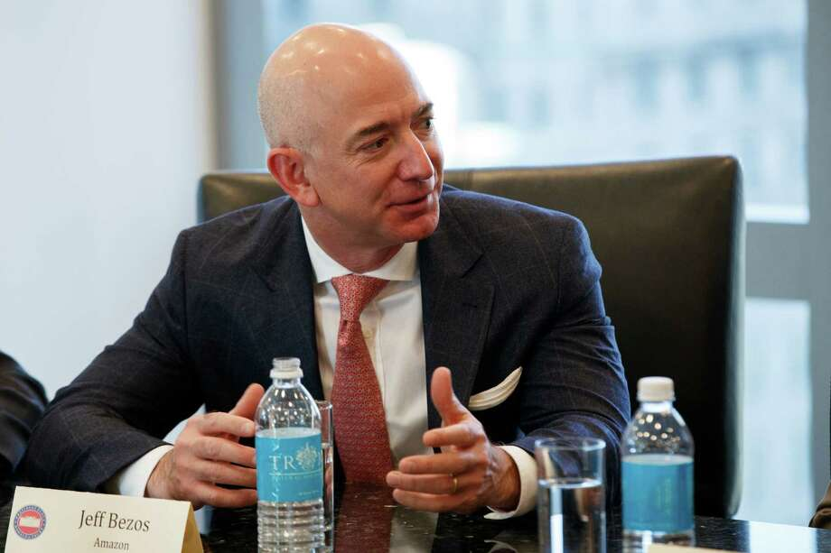 Amazon founder Jeff Bezos speaks during a meeting with President-elect Donald Trump and technology industry leaders at Trump Tower in New York, Wednesday, Dec. 14, 2016. (AP Photo/Evan Vucci) ORG XMIT: NYEV112 Photo: Evan Vucci / Copyright 2016 The Associated Press. All rights reserved.