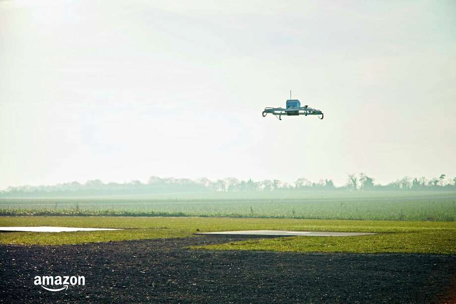 This Dec. 7, 2016, photo provided by Amazon shows an Amazon Prime Air drone in Cambridgeshire, United Kingdom.  Photo: HONS / Amazon