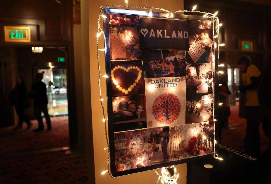 A collage in the lobby of the Fox Theater pays homage to some of the 36 people who died in the Dec. 2 Ghost Ship fire. Photo: Scott Strazzante, The Chronicle