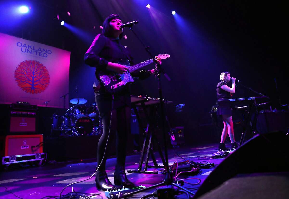 Kennedy Ashlyn and Anya Taylor perform during Oakland United: Benefit Concert for Oakland Fire Victims at Fox Theater in Oakland, Calif., on Wednesday, December 14, 2016. Fire victim Cash Askew was one of two members of the band Them Are Us Too and had been performing with bandmate Kennedy Ashlyn since 2013.