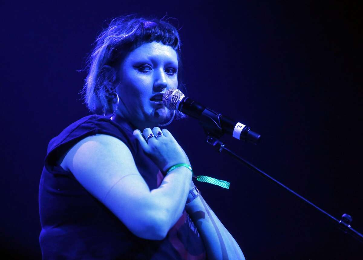 Kennedy Ashlyn performs during Oakland United: Benefit Concert for Oakland Fire Victims at Fox Theater in Oakland, Calif., on Wednesday, December 14, 2016. Fire victim Cash Askew was one of two members of the band Them Are Us Too and had been performing with bandmate Kennedy Ashlyn since 2013.