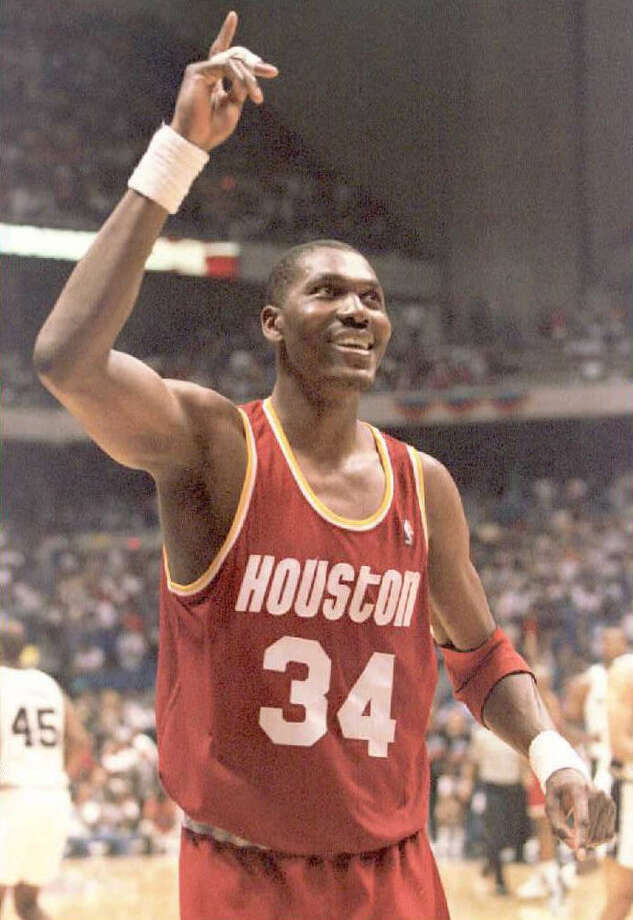 SAN ANTONIO, UNITED STATES: Hakeem Olajuwon of the Houston Rockets walks off the court after leading the Rockets to a 106-96 victroy against the San Antonio Spurs 24 May during game two of the Western Conference finals game at the Alamodome in San Antonio,Texas. Olajuwon leads the Rockets with 41 points and take a 2-0 lead back to Houston. AFP PHOTO AFP PHOTO (Photo credit should read JEFF HAYNES/AFP/Getty Images) Photo: JEFF HAYNES, Stringer / AFP