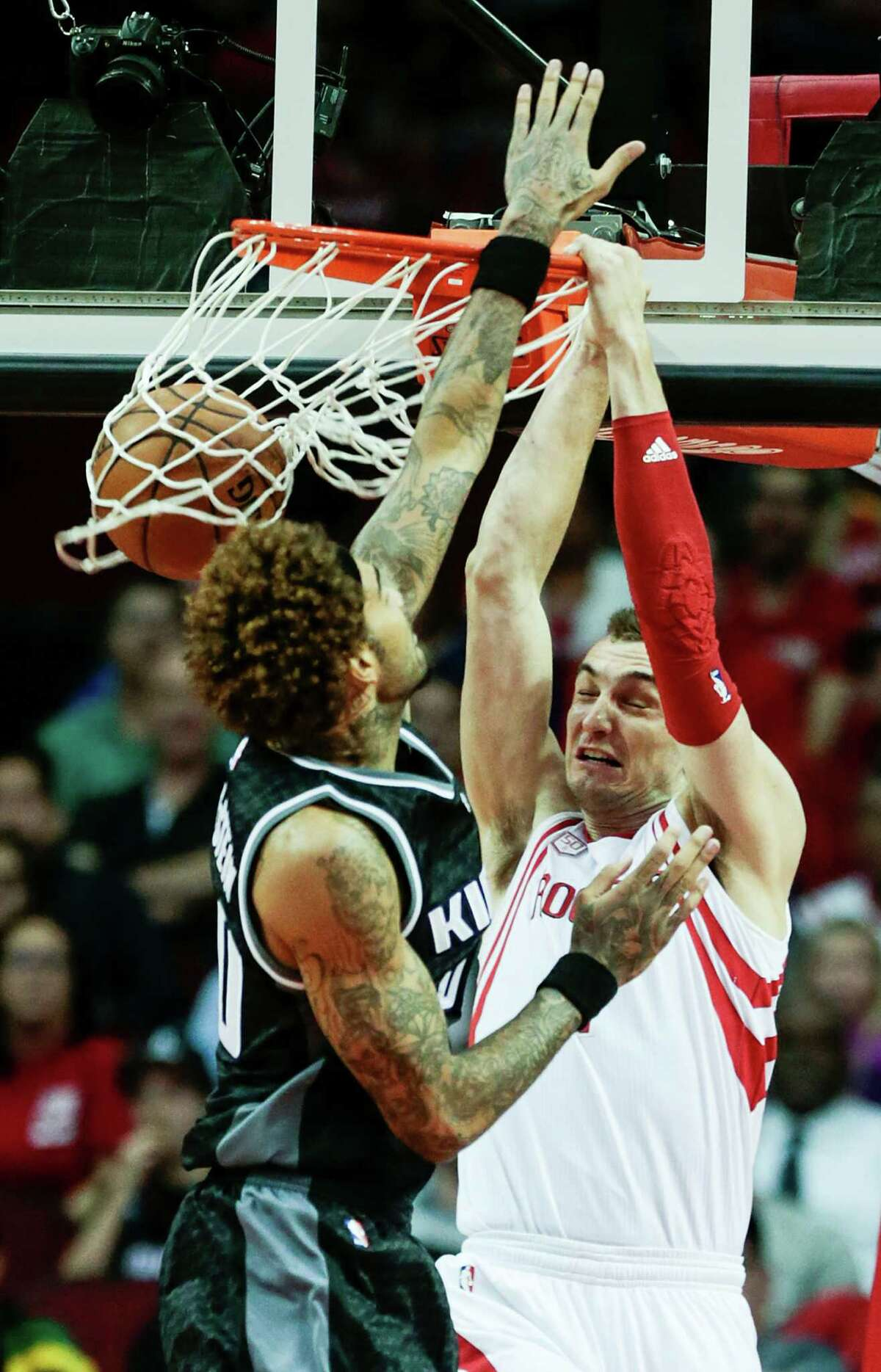 The Kings' Willie Cauley-Stein, left, arrives too late to prevent Rockets forward Sam Dekker from dunking in two of his career-high 19 points Wednesday night.