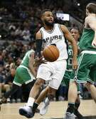 Spurs' Patty Mills (08) dishes off the ball against the Boston Celtics during their game at the AT&T Center on Wednesday, Dec. 14, 2016. (Kin Man Hui/San Antonio Express-News)