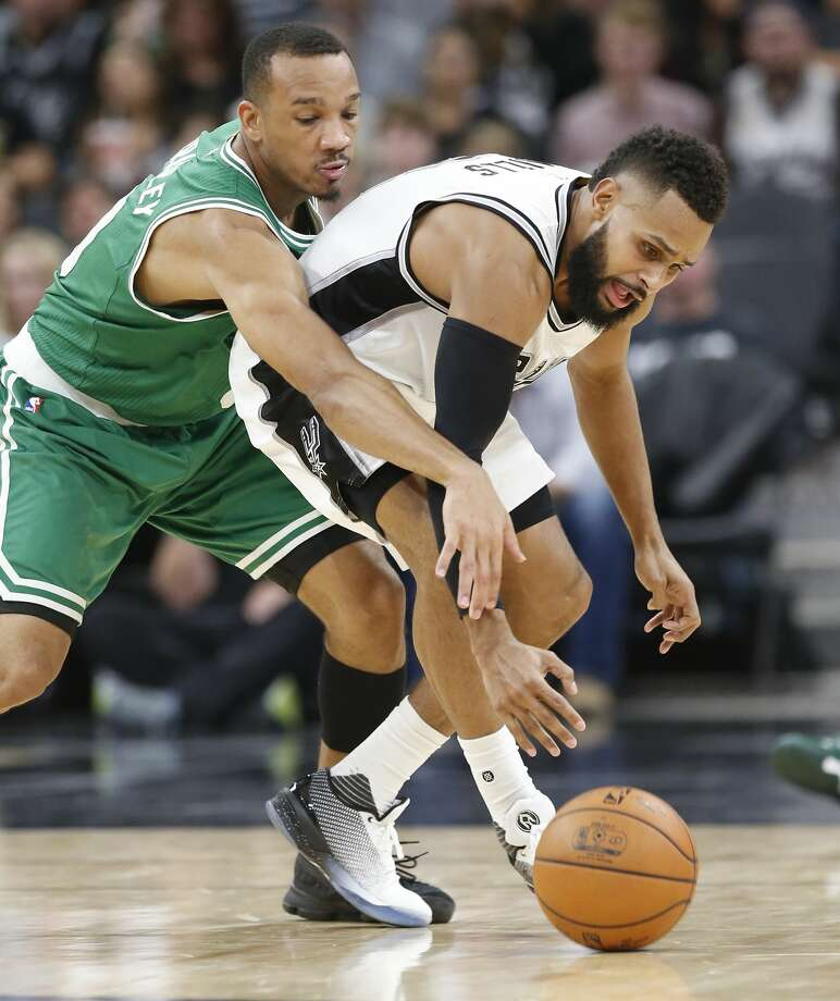 Spurs' Patty Mills (08) attempt to regain control of the ball against Boston Celtics' Avery Bradley (00) during their game at the AT&T Center on Wednesday, Dec. 14, 2016. Spurs defeated the Celtics, 108-101.(Kin Man Hui/San Antonio Express-News) Photo: Kin Man Hui/San Antonio Express-News