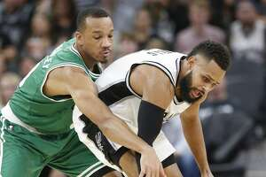 Spurs' Patty Mills (08) attempt to regain control of the ball against Boston Celtics' Avery Bradley (00) during their game at the AT&T Center on Wednesday, Dec. 14, 2016. Spurs defeated the Celtics, 108-101.(Kin Man Hui/San Antonio Express-News)