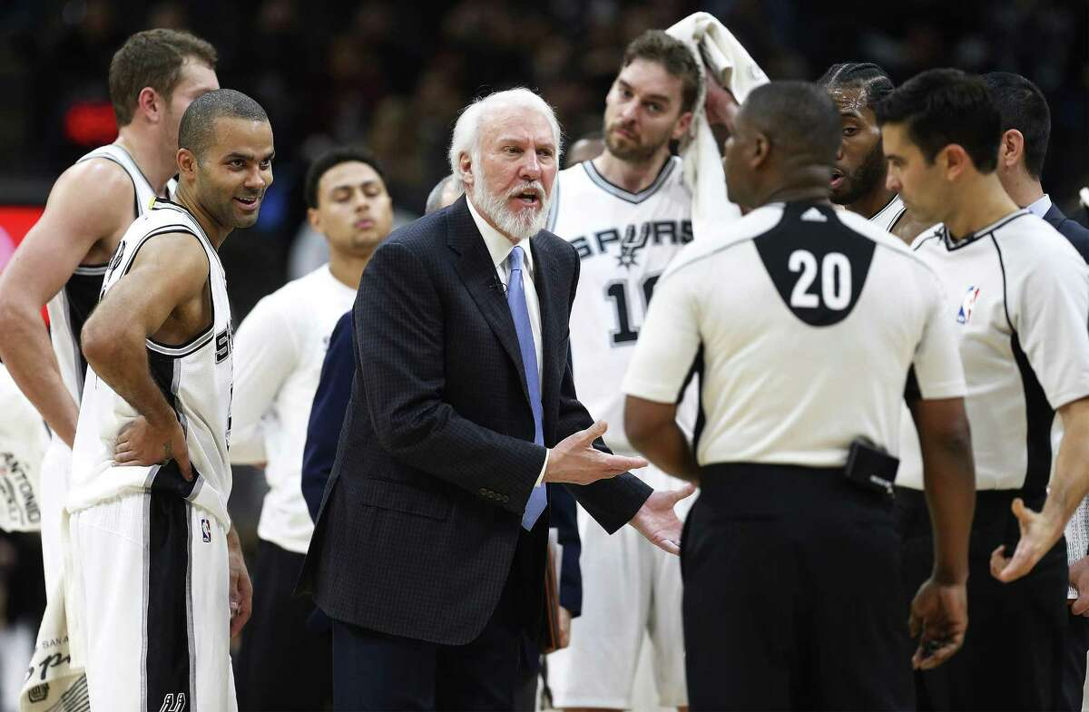 Gregg Popovich (center) has an animated discussion with game officials during the Spurs' game with Boston on Dec. 14 at the AT&T Center.