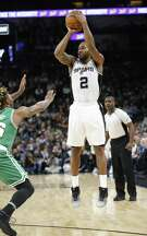 Spurs' Kawhi Leonard (02) looks to drill a jumper against Boston Celtics' Marcus Smart (36) during their game at the AT&T Center on Wednesday, Dec. 14, 2016. (Kin Man Hui/San Antonio Express-News)