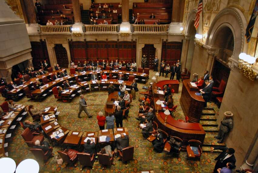 PHILIP KAMRASS/TIMES UNION -- Electors cast their ballot in a box for President-elect Barack Obama in the New York State Senate chamber during the 2008 New York State Electoral College in the Capitol in Albany, NY Monday December 15, 2008.