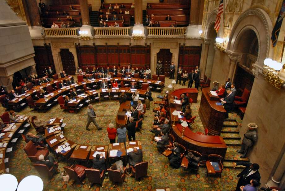 PHILIP KAMRASS/TIMES UNION --  Electors cast their ballot in a box for President-elect Barack Obama in the New York State Senate chamber during the 2008 New York State Electoral College in the Capitol in Albany, NY Monday December 15, 2008. Photo: PHILIP KAMRASS, ALBANY TIMES UNION