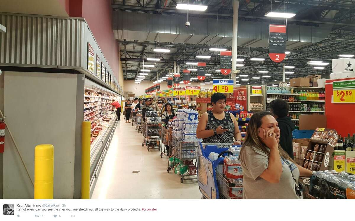 """""""It's not ever day you see the checkout line stretch all the way to the dairy products. #cctxwater,"""" @CallerRaul."""