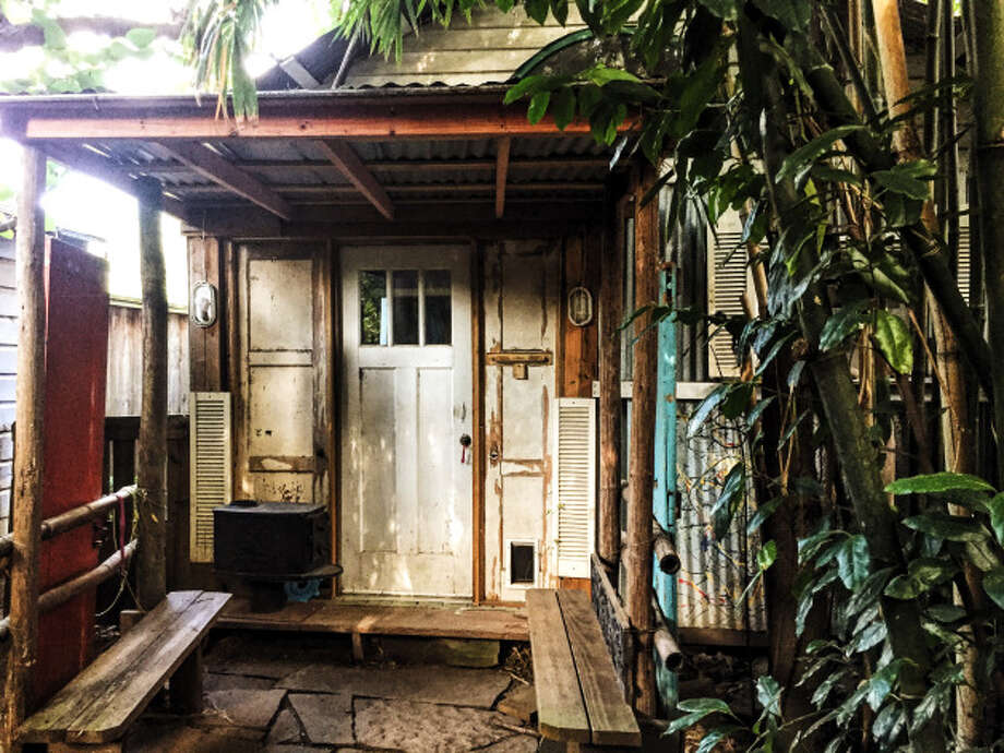 In her 13 years of living in the Heights, Lizzy Hargrove has made her yard a jungly paradise. This photo: The house's back entrance. Photo: Lucas Masllorens / Modest Digs