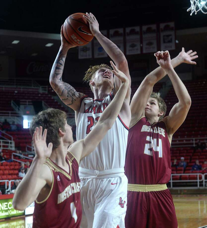 Lamar's Colton Weisbrod is pressed by Austin College's John Pass (left) and J.P. Feider during Saturday's match-up at the Montagne Center. Photo taken Saturday, December 10, 2016 Kim Brent/The Enterprise Photo: Kim Brent / Beaumont Enterprise